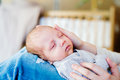 Unrecognizable mother with newborn baby son sitting on bed Royalty Free Stock Photo