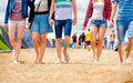 Unrecognizable teenagers, tent music festival, sunny summer, leg Royalty Free Stock Photo