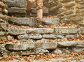 Unrecognizable woman walking down the stone staircase old in autumn outdoor view of legs Royalty Free Stock Photo