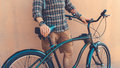Unrecognizable Young Hipster Man Holding Hands On His Bicycle While Standing Near Wall Holiday Activity Concept Royalty Free Stock Photo