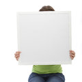 Unrecognized woman covering her face using a blank white board Royalty Free Stock Photo