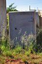 Unsafe safe an abandoned heavy duty with grass growing all round the base concrete and steel construction an investment or Royalty Free Stock Image