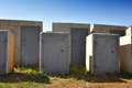 Unsafe safes a grouping of abandoned heavy duty with grass growing all round the base concrete and steel construction an Stock Photos