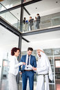 Unsatisfied managers at meeting with arabian man young on businessman full length Stock Photo