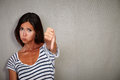 Unsatisfied young lady showing disapproval sign Royalty Free Stock Photo