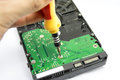 Unscrew the scheme from the hard drive with a screwdriver Stock Photography