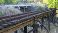An unsed railway bridge running adjacent to the highway a built in modern Royalty Free Stock Image
