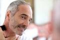 Unshaven mature man using razor senior shaving beard with electric Royalty Free Stock Photos