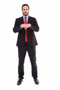 Unsmiling businessman with clenched fist in front of him on white background Stock Photo