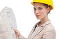 Unsmiling woman architect with yellow helmet Stock Photos