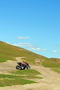unsurfaced road and all terrain vehicle Royalty Free Stock Photo