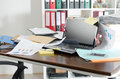 Untidy and cluttered desk Royalty Free Stock Photo