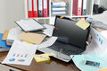 Untidy and cluttered desk view of a Royalty Free Stock Images