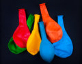 Unused party baloons on the black background closeup Royalty Free Stock Image