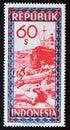 Old unused postage stamp Republic Indonesia 1949, Workers Harbor scene Royalty Free Stock Photo