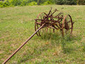 Unused and rusted farm plow in field Royalty Free Stock Photos