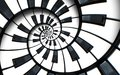 Unusual abstract piano keyboard spiral background fractal like endless staircase. Black and white piano keys screwed into round s Royalty Free Stock Photo