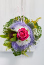 Unusual floral posy incorporating a blue textile Royalty Free Stock Photo