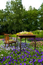 Unusual flowerbed in uppsala sweden an the shape of a table and chair Royalty Free Stock Photos