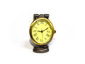 Unusual yellow clock with roman numerals on a white background Royalty Free Stock Photo