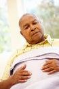Unwell senior african american man Stock Photography