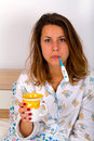 Unwell woman beautiful laying in the bed and drinking hot tea Royalty Free Stock Photos