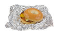 Unwrapped breakfast bagel sandwich on tinfoil a slightly opened upon crinkled aluminum foil Royalty Free Stock Photos