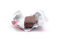 Unwrapped candy on white background Stock Image