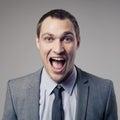 Uomo d affari felice screaming Fotografia Stock Libera da Diritti