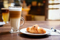 Up of coffee and croissant Royalty Free Stock Photo