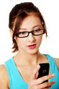 Upclose portrait of girl reading sms. Royalty Free Stock Photos