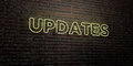 UPDATES -Realistic Neon Sign on Brick Wall background - 3D rendered royalty free stock image