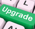 Upgrade key means improve or update on keyboard meaning better Stock Photos