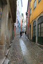 Uphill on coimbra street going a cobblestone in portugal a rainy day Stock Image