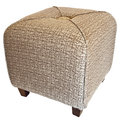 Upholstered cube ottoman footrest with wood legs Stock Photos
