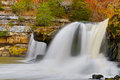 The upper cataract indiana s falls pour through boulder int he midst of fall foliage color Stock Image