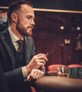 Upper class man gambling in a casino Royalty Free Stock Photo