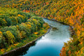 Upper delaware river bend bends through a colorful autumn forest near port jervis new york Royalty Free Stock Photos