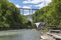 The upper falls and railroad trestle at letchworth state park in new york Royalty Free Stock Photos