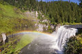 Upper mesa falls in western idaho with a faint rainbow formed by the mist produced by the Stock Images