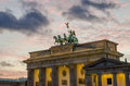 Upper part of Brandenburger Tor in Berlin with pink evening light and soft clouds, winter, Germany Royalty Free Stock Photo