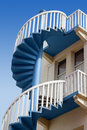 Upper section of spiral stairs against clear blue sky Royalty Free Stock Photos