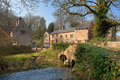 Upper swell the old bridge at the cotswold village of near stow on the wold gloucestershire england Stock Image