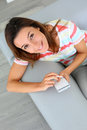Upper view of girl writing message on smartphone woman in sofa using Royalty Free Stock Photography