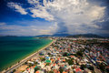 upper view of resort city near azure sea with long beach highway Royalty Free Stock Photo