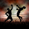 Uppercut editable vector silhouette of a boxer knocking out his opponent with an punch with background made using a gradient mesh Stock Photos