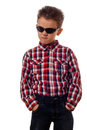 Uppity boy with sunglasses portrait of a in checkered shirt and jeans looking Royalty Free Stock Images