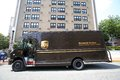 Ups package logistics west new york n j thur july an united parcel service delivery truck on a street corner in west new york n j Stock Photo