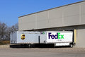 Ups vs fedex grapevine texas usa – march and trailers parked next to each other at a loading dock in grapevine texas the Royalty Free Stock Photography