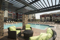 Upscale pool area view of large apartment complex Stock Photos